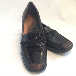 Patent Meucci slip on shoes with twist detail